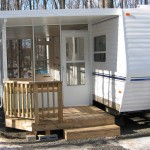 three season room with a front porch attached to RV