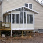 completed sun room addition with siding to match the house