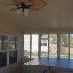 large ceiling fan and hot tub installed inside sun room