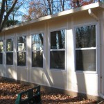 custom sun room addition built for home in the woods