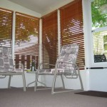 sun room with wall to wall carpeting and patio furniture