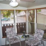 sun room with ceiling fan and patio furniture