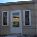 combo room with custom door, with matching siding