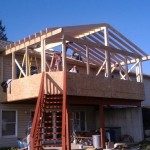 Machose Contracting team installing the skeleton of a home addition project