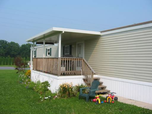 Small White Roof Built Over Front Porch On Mobile Home
