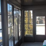 view of backyard from wraparound windows on custom combo room