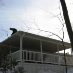 home improvement contractor working on top of roof