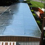 mobile home with old tin roof before re-roofing