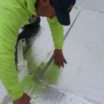 contractor preparing roof for re-roofing process