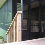 custom black three season room built attached to wooden deck
