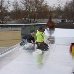 contractors laying out foundation for re-roofing