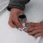 contractor installing new roof to mobile home