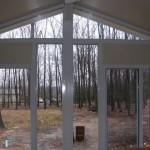 large triangular windows installed for custom sun room