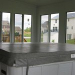 hot tub installed inside custom sun room for use all year