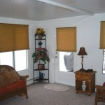 sun room with furniture, carpeting, and window features to look like inside of house