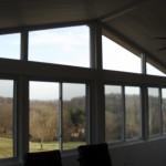 view of backyard from large wraparound windows
