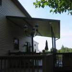 large roof installed over back porch
