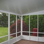 view from sunroom into the backyard and hedges