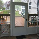 sunroom with door leading out onto a custom built deck