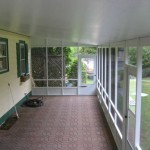 finished sunroom attached to the back of house