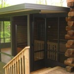 custom black three season room built attached to log house